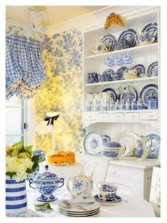 What a wonderful dining room! light & bright, full of blue & white. :)