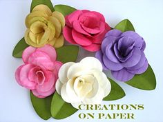Fancy Paper Flower Tutorial  Your's will be just as gorgeous as these are when you make them.  Great instructions to follow!