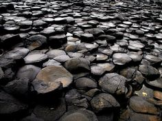 The Giant's Causeway, Northern Ireland: an area of about 40,000 interlocking basalt columns, the result of an ancient volcanic eruption. | 30 Natural Phenomena You Won't Believe Actually Exist