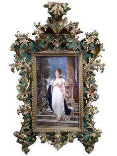 antique frame. maybe refinish a thrifted frame and put matting of some sort behind for color. hmmm. . . .