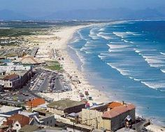 Muizenberg is a good place for beginners to learn to surf, Gary offers reasonably priced lessons from a shop facing the beach. Don't forget that the False Bay area (where Muizenberg is located in addition to Kalk Bay and Fish Hoek) is known for its sharks!  Also popular for kite surfing.  Source: WikiTravel