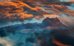 Double exposure from a photos of Kinabalu Mountain and sunset sky.