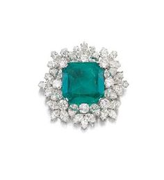 The Bulgari emerald and diamond brooch, weighing 27.57 carats, sold for £703,267