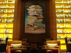 """Celebrity Solstice [Royal Caribbean International cruise liner]. Library. Books,"" photo by tom Mascardo 1, oil on canvas is by Cornelius Volker, 1965"