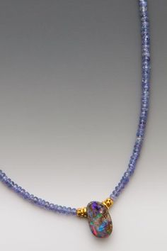 Wish: An exquisitely dainty Australian boulder opal - full of fire as well as…