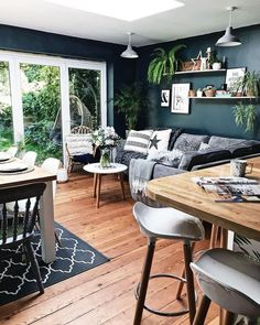 Gone are the sage green walls and in with the Hague Blue. Love how everything pops against this colour Dark Living Rooms, Living Room Green, Living Room Kitchen, Interior Design Living Room, Home And Living, Living Room Designs, Dark Floor Living Room, Sage Green Walls, Green Kitchen Walls