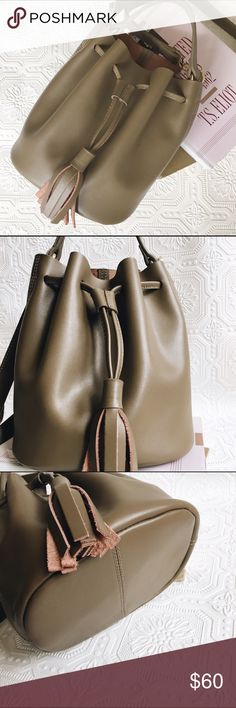 "KC Jagger Taupe Tori Leather Mini Bucket Bag In perfect condition! A perfect neutral color and soft, real leather. Bucket bag with a tassle ended drawstring and gold hardware. The bag has a carrying handle and a detachable shoulder or crossbody strap with a 20"" drop. Features a convenient removable zipper compartment inside. Bag measures 8""W x 9""H x 6""D. Bags Mini Bags"