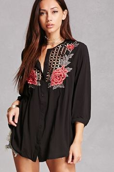 A woven tunic featuring a sheer netted crochet yoke, embroidered floral front detailing, a button-down front, 3/4 length sleeves with button-cuffs, and a shift silhouette.<p>- This is an independent brand and not a Forever 21 branded item.</p>