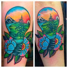 Light bulb scene in scene tattoo. Done by Jeff Gombosi @ Garland Tattoo in Spokane, WA. Midnight Sun, Sitka Spruce tree, Thunder Mountain, lotus.