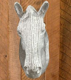"""Horse Head Wall Art made of Paper Mache. Covered in pages from """"Oliver Twist"""". Perfect for your equestrian-themed library. Available at Red Scarf Equestrian."""
