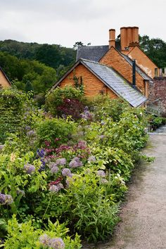 """[i]An area of herbaceous planting borders the kitchen garden.[/i]  Like this? Then you'll love  [link url=""""http://www.houseandgarden.co.uk/outdoor-spaces/features/garden-rooms""""]Garden rooms[/link]"""
