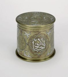 Trench Art from WWI :: An engraved tobacco jar made by a Turkish prisoner of war using a British 13-pound brass shell case. Inlaid with copper and silver wire.