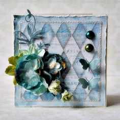 beautiful card in blue and aqua. such lovely flowers and stitched detail. LOVE