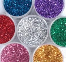 Glitter sugar!!!    1/4 cup sugar, 1/2 teaspoon of food coloring, baking sheet and 10 mins in oven