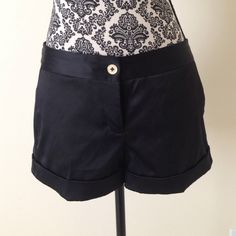 Black Satin Shorts Black Satin Shorts. 97% Polyester 3% Spandex. Gold buttons and side clasps. Front and back pockets. Cuffed legs. Express Design Studio Shorts