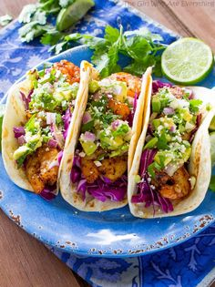 These Grilled Shrimp Tacos with Avocado Salsa are a light and refreshing dinner recipe! the-girl-who-ate-everything.com