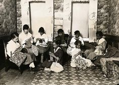 Eight women of color knitting together. No info about who or where. A mysterious photo with a CORBIS watermark, but not finding it on search.