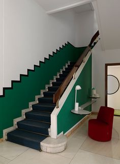 Black steps with painted wall by Studio Pepe