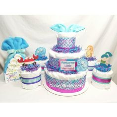 Check out this item in my Etsy shop https://www.etsy.com/listing/544203493/mermaid-themed-diaper-cake-gift-set