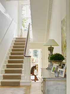 Maybe white stairs and banisters to match molding. Only wood stain railing. Carpet runner of course