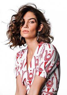 Wearing print, Lily Aldridge models Miu Miu dress and Bulgari earrings