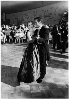"Joanne Woodward dances with husband actor Paul Newman at the 1st Governor's Ball held at the Bali Room of the Beverly Hilton Hotel following the Academy Awards where she won the Oscar for Best Actress for her role in ""Three Faces of Eve"", LA, 1958 ~ Photograph J. R. Eyerman"