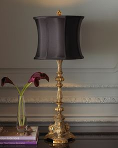 """Etienne"" Lamp at Horchow. $147 The hand-cast tripod base of this lamp is a replica of a candleholder we saw in France. Shade is silk doupioni with black and golden stripes on its interior for a little punch. 12""Dia. x 34""T. Uses one 75-watt bulb. Imported."
