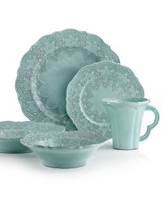 Handcrafted in the Italian tradition, Merletto  dinnerware from Arte Italica is intricately embellished with a lacy floral texture and painted a serene aqua hue.  Hand-painted earthenware.