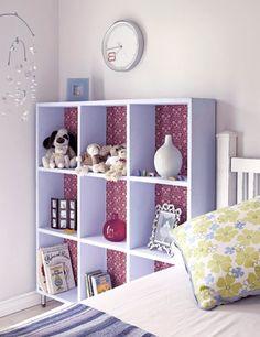 Cute wallpaper lining on book shelf
