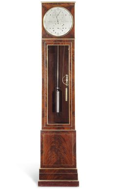 A Regency brass-inlaid mahogany longcase regulator by Benjamin Vulliamy, circa 1820, with a case by T. N. Lowther. Courtesy of Christie's