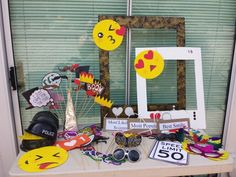 Photo booth props. Emoji masks, frames, sunglasses, beaded necklaces, feather masks...