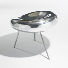 SANAA (KAZUYO SEJIMA AND RYUE NISHIZAWA)    Drop chair    Japan, 2005  cast and polished aluminum, steel  23 w x 24 d x 19.5 h inches  This chair was originally designed for the 21st Century Museum of Contemporary Art in Kanazawa, Japan.