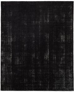 Black Distressed Wool Rug: Masterfully handcrafted using select yarns and antique pedal looms, alternating rows of looped and sheared wool create varied dimension and texture while heavy distressing produces a deeply worn, antiqued finish. The effect is vintage, but the construction is exceedingly long-wearing. Imported.
