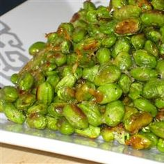 Crispy Edamame... drizzle frozen edamame with olive oil, add some Parmesan cheese, and roast at 400 degrees for 15 minutes.yum!