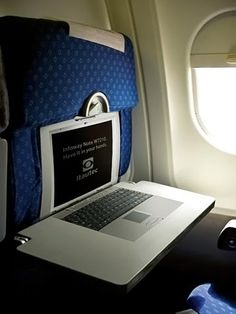 10 Coolest Ads on Airplanes - A decal for a Brazilian laptop brand placed on tables in an airplane. Awesome. (http://bhingkayz.com/2009/07/crazy-funny-billboards/)