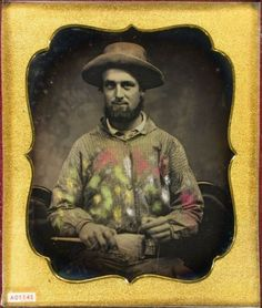 ca. 1850's, [daguerreotype portrait of an artist gentleman holding a paintbrush, wearing an apron with creative hand tinting]