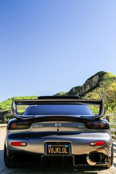Sometimes I'm jealous of the view people behind me get. Mazda RX-7. [2000x3000] [OC] : carporn
