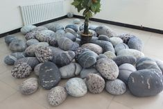 life-like stone pillows. Pebble Pillows. plush fabric. rock pillows. mixed set. awesome.