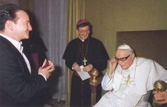 """Pope John Paul II trying on Bono's sunglasses.""  (!!!)"