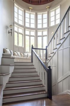 Staircase with window seat.