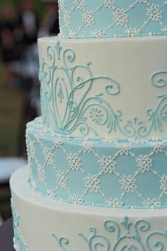 The intricate design on the cake was inspired by a gorgeous eyelet wedding dress.