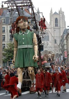 The Royal De Luxe theater group's giant marionette. - kind of an art doll on steroids