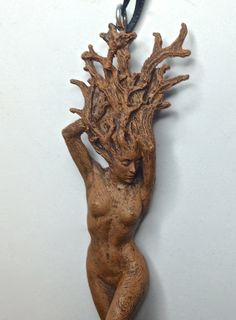 Ornament of a sculpted Dryad tree spirit  hand painted resin with a ribbon loop, 6 tall