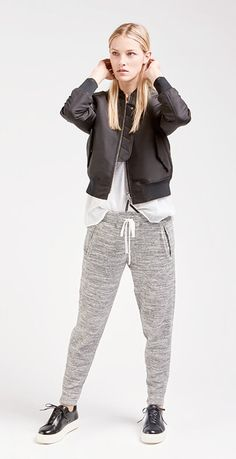 There's something undeniably sexy about his-for-her dressing—loose-fitting track pants, an oversized tee, and sneakers, the slick bomber jacket pulls it all together.