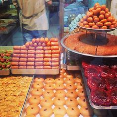 instanbulEatsTour:Beyoglu: everywhere the most b'tiful baklava shops. Red=quince in spiced syrup