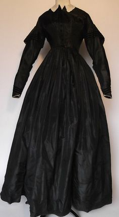 Mourning Dress: ca. 1860's, silk taffeta with polished cotton lining, finished with velvet piping, wool binding. Could be a maternity gown.