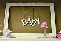 Neat DIY idea for decorating baby's room - except in the empty frame I'd hang lettering that spells out baby's name. This gives me a great idea for a gift to make.