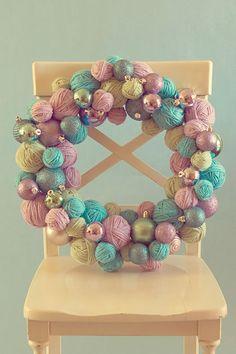 yarn ball wreath // diy + photo by kristi, life through the lens http://www.lifethroughthelensblog.com/2010/11/yarn-ball-ornament-wreath-tutorial.html