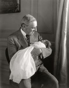 President Woodrow Wilson and new grandson in 1915, less than a year after the death of his wife, Edith.