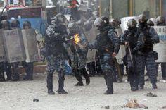 Ukraine, 2014. Police prepare to throw back molotovs